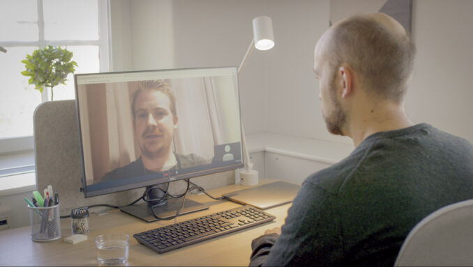 Physician having a virtual meeting with a patient